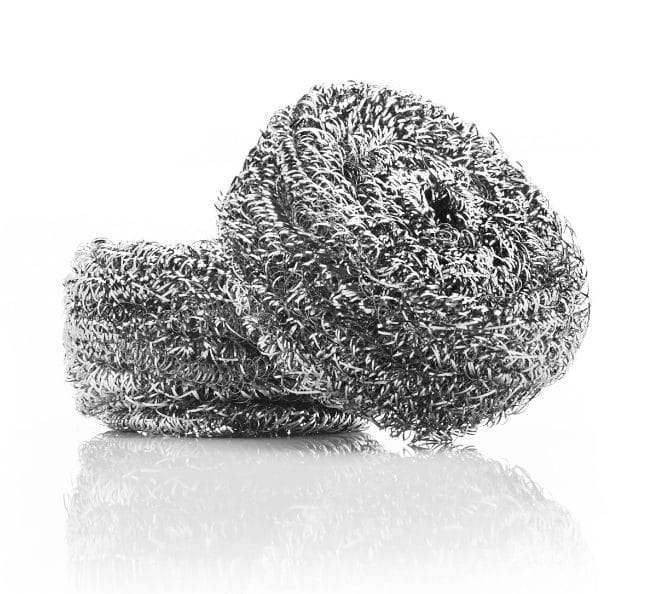 Close-up of two stainless steel sponges