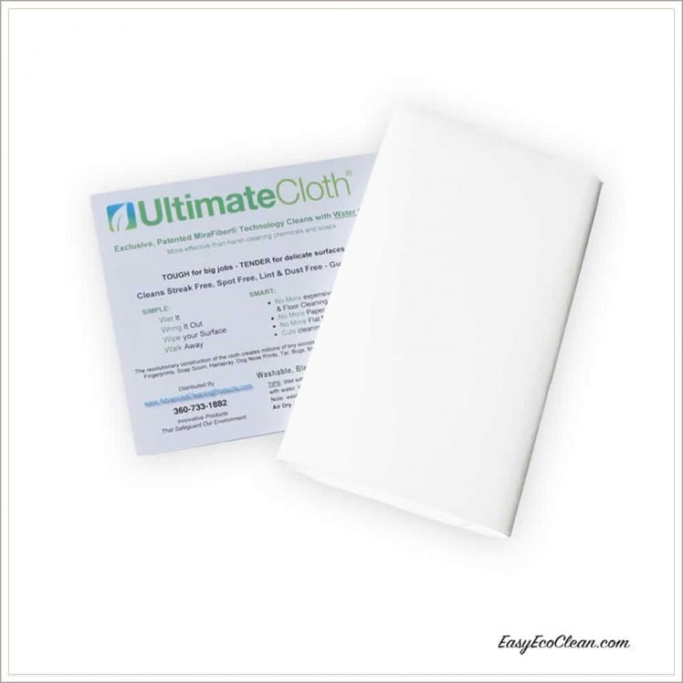 Image of a folded white Ultimate Cloth with information sheet in background