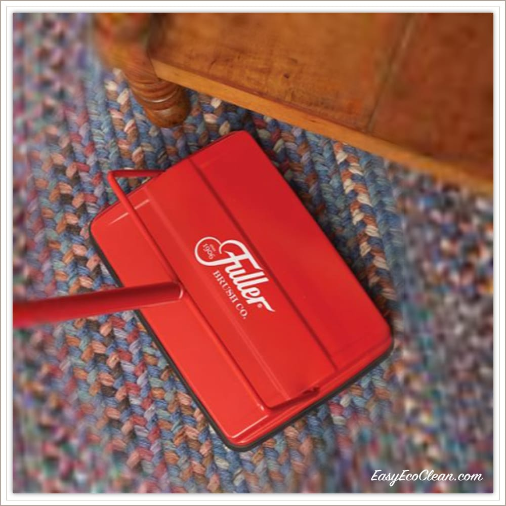Red Fuller Brush Electrostatic Sweeper being used on braided carpet