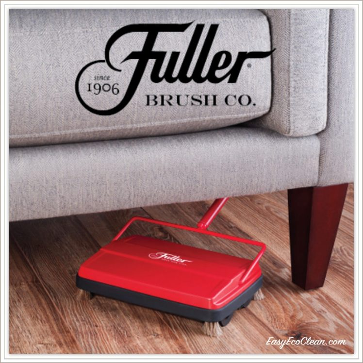 Fuller Brush logo on picture of electrostatic sweeper picking up debris on wood floor under couch